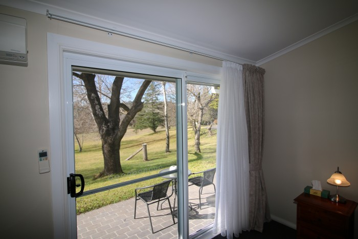 View of the grass outside the patio in one of the beautiful suites in the best accomodation in Armidale