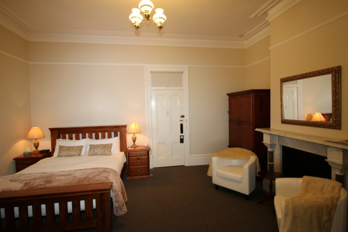 An inviting room with a double bed ready for guests at the best place to stay in Armidale