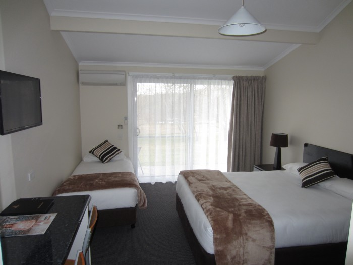 Queen and single bed room at Moore Park Inn