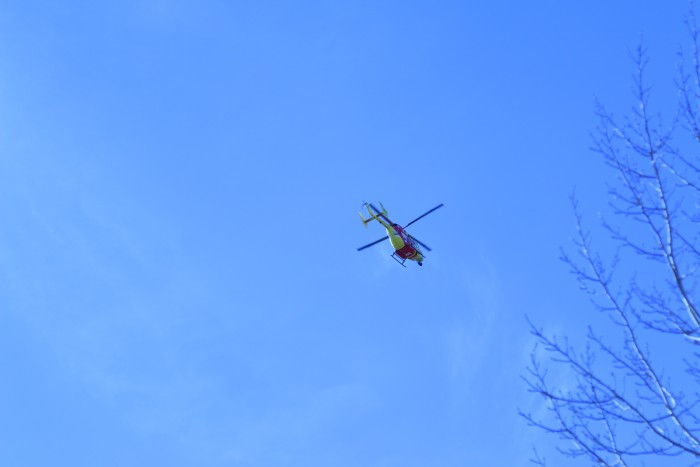 A helicopter is flying over places to stay in Armidale