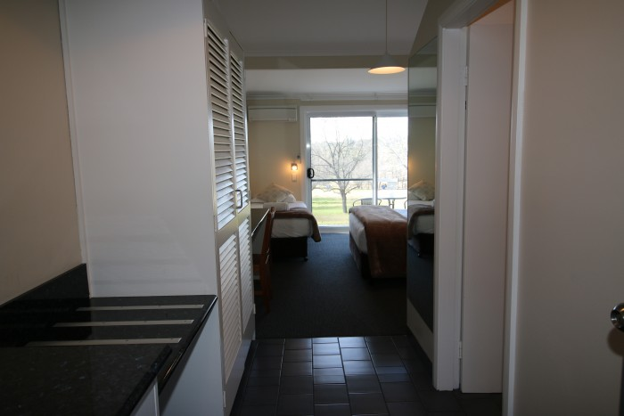 Large Room at Moore Park Inn, kitchenette, storage options, Queen Bed and single bed.
